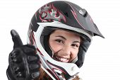 picture of motocross  - Happy biker woman with a motocross helmet and thumb up isolated on a white background - JPG