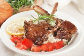 stock photo of lamb chops  - Roasted lamb chops with couscous - JPG