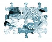 Six individual jigsaw piece shapes filled with financial images and toned blue.
