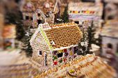 picture of gingerbread house  - A classic gingerbread house in the middle of a candy village - JPG