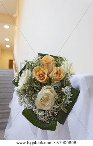A bouquet of yellow and white roses