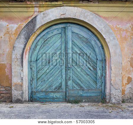 Old Grungy Wooden Door, Peeling Plaster Around