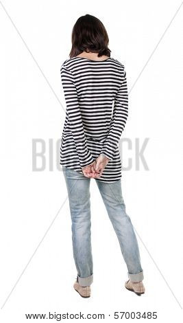 back view of standing young beautiful  brunette woman in striped frock. girl  watching. Rear view people collection.  backside view of person.  Isolated over white background.