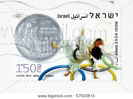 ISRAEL �¢�?�? CIRCA 2004: Stamp printed in Israel depicts a silver metal and judo competition In summer Olympics in Athens, circa 2004.