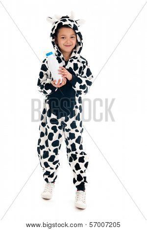 Little boy dressed as cow with bottle of milk