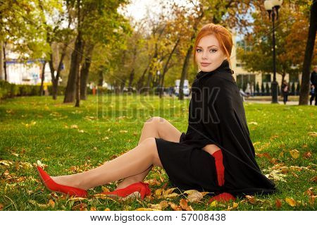 Portrait Of A Beautiful Red-haired Woman