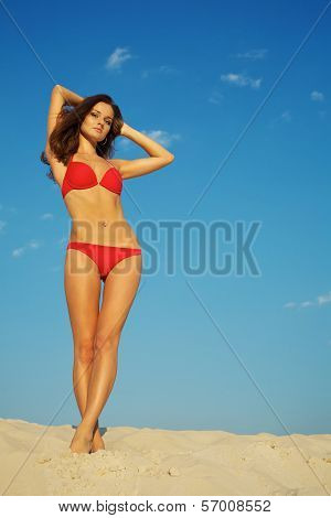 Beautiful Woman Posing On Sand
