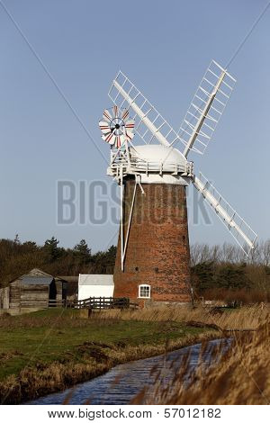 Horsey Wind Pump, or Horsey Mill as it is also known, an old drainage pump on reclaimed land in Norfolk, on the East Coast of England. The old wind pumps have been replaced with diesel pumps.