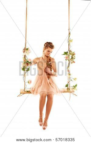 Beautiful girl swinging