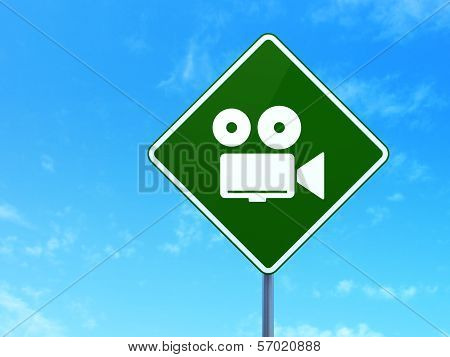 Vacation concept: Camera on road sign background
