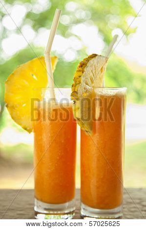 Fresh Juice With Pineaple Slice On A Side