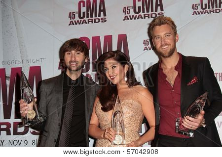 Dave Haywood, Hillary Scott and Charles Kelley of Lady Antebellum at the 2011 CMA Awards, Bridgestone Arena, Nashville, TN 11-09-11