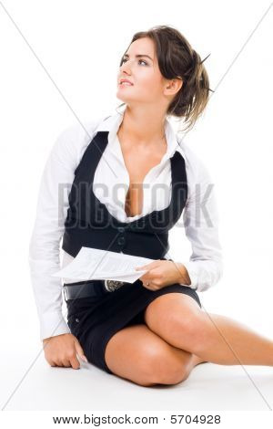 Woman In Formal Clothes Sitting On The Floor