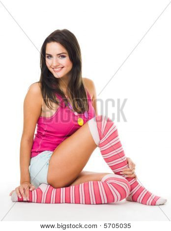 Woman In Pink Socks With Long Hair Sit And Look At Camera