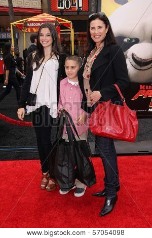Mimi Rogers and children at the