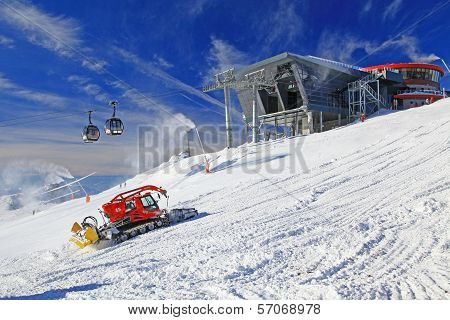 Modern Cableway And Groomer In Ski Resort Jasna, Slovakia