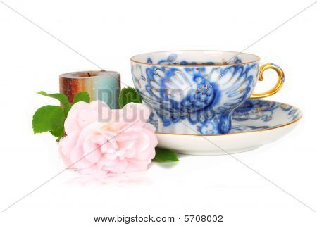 Rose, Candle And Blue Cup Of Tee.
