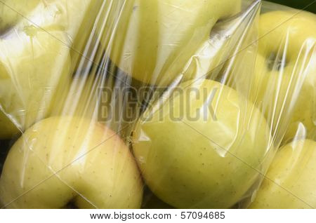 Yellow Golden Apples Packed In Plastic Film