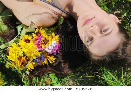 Woman Lays In A Grass