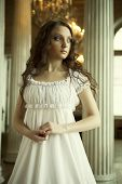 stock photo of edwardian  - Portrait of a beautiful young victorian lady in white dress - JPG