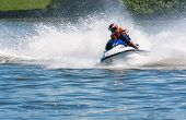 pic of ski boat  - Men riding wave runner in the river - JPG