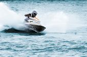 picture of jet-ski  - Man on a high speed jet ski with splashes - JPG