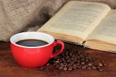 image of sackcloth  - Cup of coffee with coffee beans and book on wooden table on sackcloth background - JPG