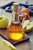 picture of cider apples  - Apple cider vinegar in glass bottle and fresh apples - JPG