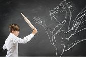 picture of terrorism  - Concept of courageous child with drawing of dragon - JPG