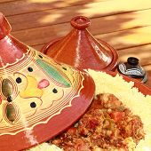 stock photo of tagine  - macro of tagine with couscous a sunny day - JPG