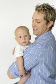 stock photo of newborn baby  - Father holding his son on white background - JPG
