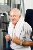 Older Man Exercising At The Gym