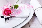 pic of sweethearts  - Romantic formal elegant table setting with a single pink rose and decorative ribbon for a sweetheart on Valentines Day - JPG