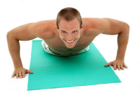 foto of fitness man body  - Young muscular man doing situp exercises on mat - JPG