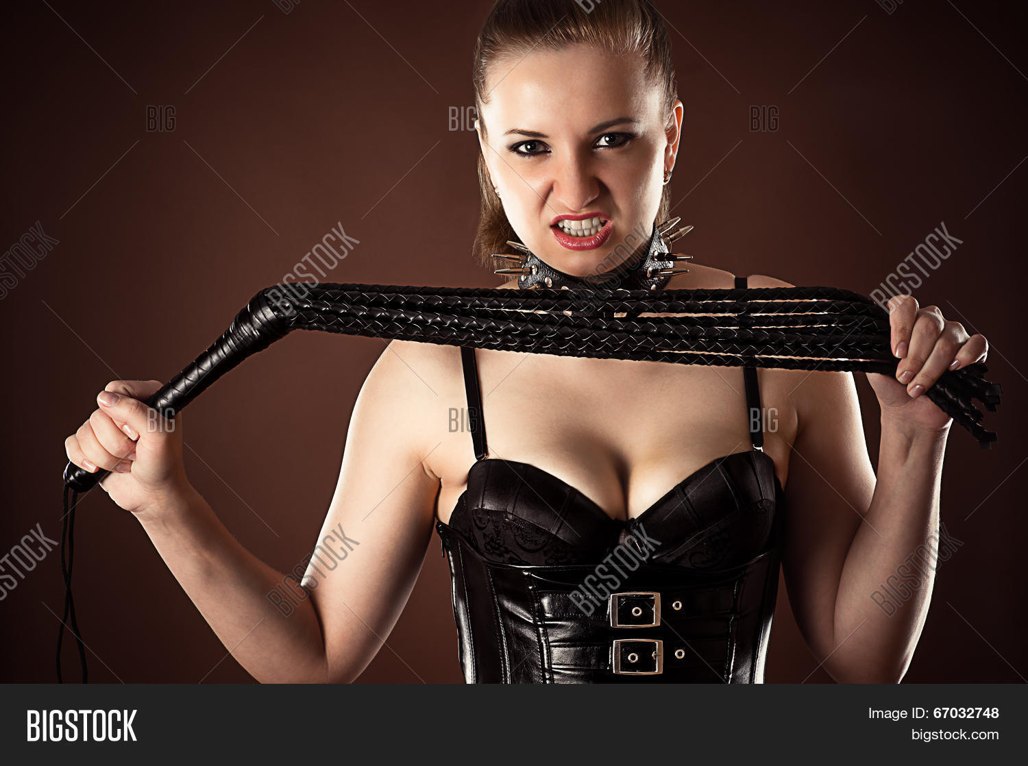 Angry dominatrix with big muscles hurts her