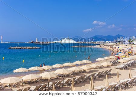 Cannes, France July 1, 2011. People relax on the beach at the seaside
