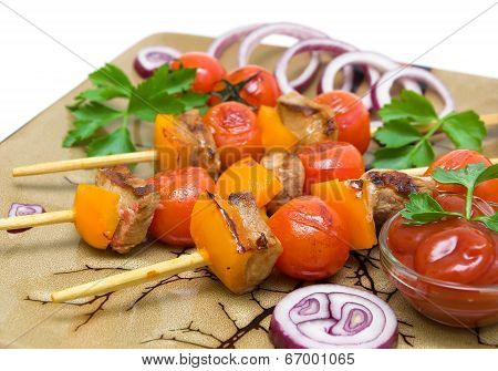 Grilled Meat And Vegetables On The Plate Closeup