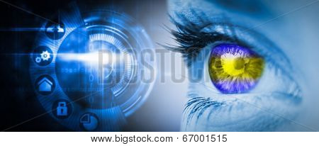 Green and yellow eye on blue face against black technology interface with glow