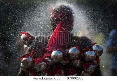 BATU CAVE, MALAYSIA - JAN 20 : A Malaysian Hindu devotee takes a ceremonial ritual shower during the Thaipusam festival at the Batu Caves temple on January 20, 2011 at Batu Cave temple, Malaysia.