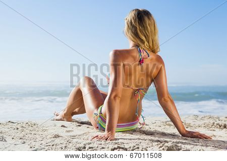 Gorgeous blonde in bikini lying on the beach on a sunny day