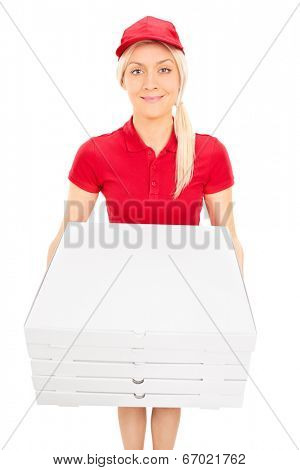 Delivery girl carrying five pizza boxes isolated on white background