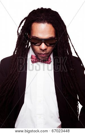 businessman wearing sunglasses and suit dreadlocks