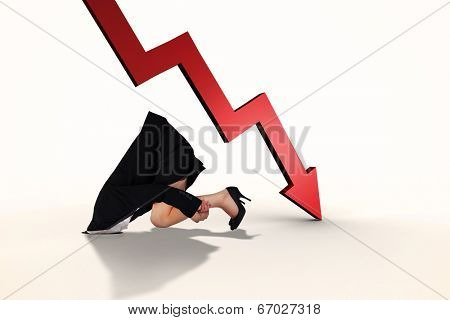 Businesswoman burying her head against red arrow pointing down