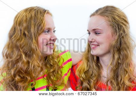 Two teenage girls embracing each other