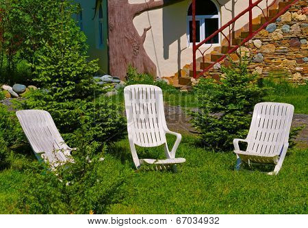 Two Desk Chairs On Green Grass
