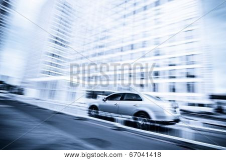 car driving in the business district,motion blur