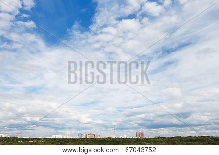 Cirrus And Cumuli White Clouds In Over City