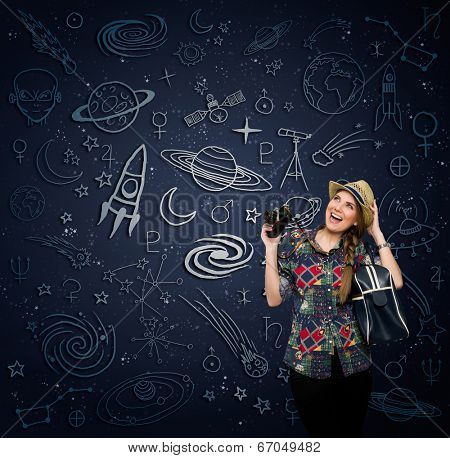 Excited woman with retro photo camera looking at draw space