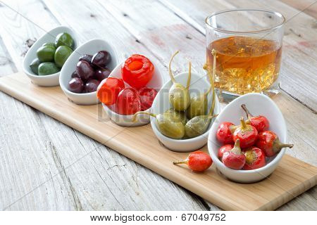 Selection Of Olives And Peppers With Whiskey
