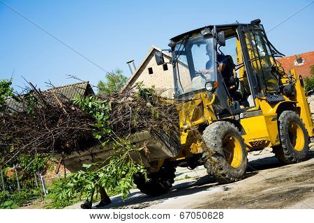 Digger In A Backyard Working
